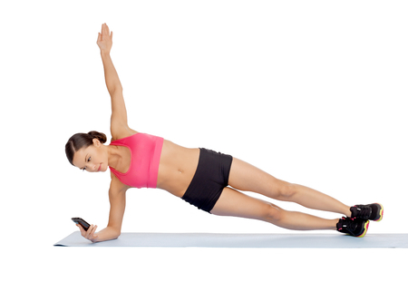 sport, fitness and healthcare concept - beautiful asian sporty woman with smartphone doing exercise photo
