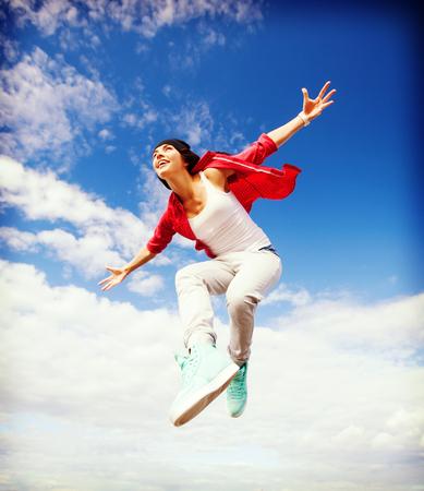 cool girl: sport, dancing and urban culture concept - beautiful dancing girl jumping