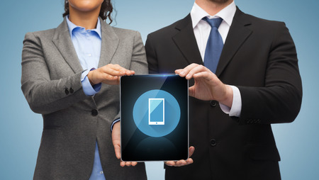 business, technology and internet concept - businessman and businesswoman with blank black tablet pc screen photo