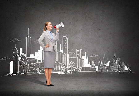 business, communication and office concept - smiling businesswoman with megaphone screaming at someone imaginary photo