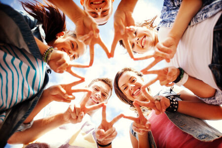 finger teen: summer holidays and teenage concept - group of teenagers showing finger five gesture