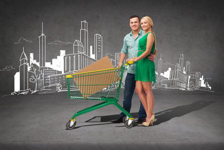 happiness,electronics, shopping and couple concept - smiling couple with shopping cart and big cardboard box in it photo