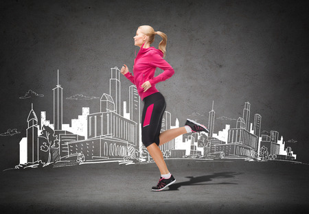 fitness, sport and dieting concept - beautiful sporty woman running photo