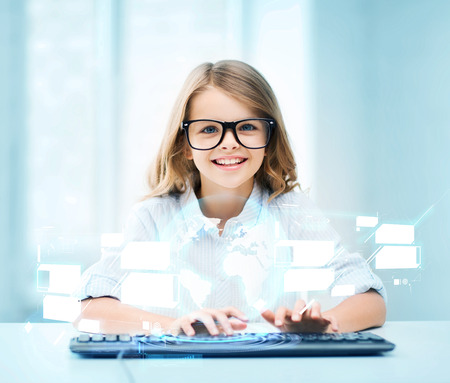 education, school and future technology concept - little student girl with keyboard and virtual screen at school photo