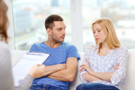 love, family, phychology and relationship problems concept - young couple with a problem at psychologist office Stock Photo