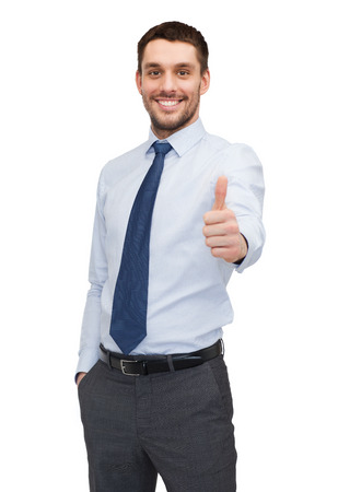 arms up: business and office concept - handsome buisnessman showing thumbs up