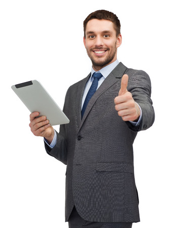 business, communication, modern technology and office concept - smiling buisnessman with tablet pc computer showing thumbs up photo