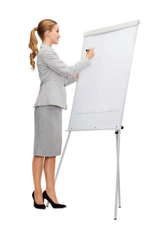 business, education and office concept - smiling businesswoman writing on flip board Stock Photo - 27640542
