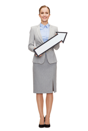 business and education concept - smiling businesswoman with direction arrow sign photo