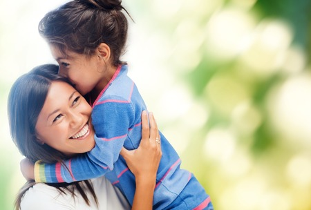 girl bonding: family, children and happy people concept - hugging mother and daughter Stock Photo