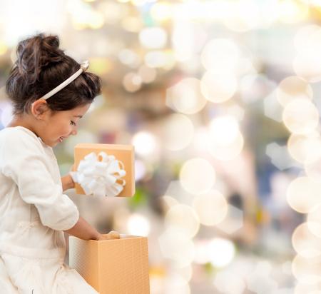 holidays, presents, christmas, x-mas, birthday concept - happy child girl with gift box photo