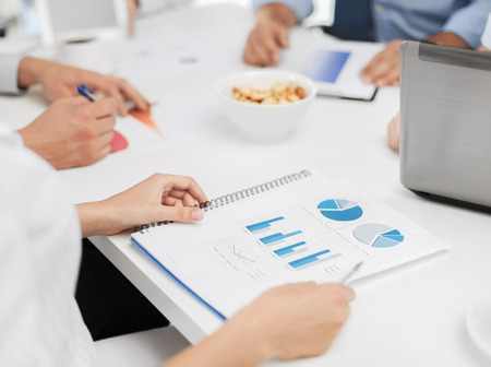 bookkeeping: office, school and education concept - business team having discussion in office
