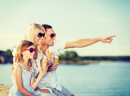 people: summer holidays, celebration, children and people concept - happy family eating ice cream