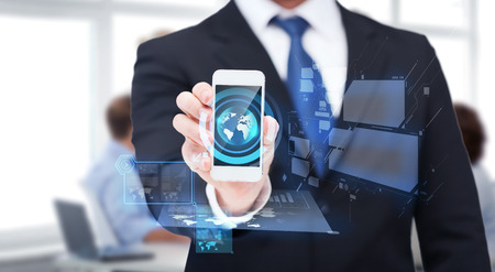 business, internet and technology concept - businessman showing smartphone with holograms photo