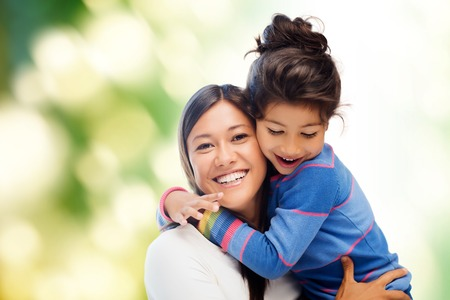 lovely girl: family, children and happy people concept - hugging mother and daughter Stock Photo