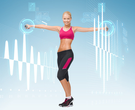 fitness, sport and dieting concept - young sporty woman with light dumbbells photo