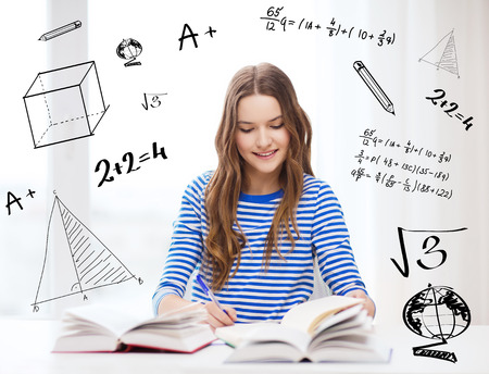 exams: education and home concept - happy smiling student girl with books