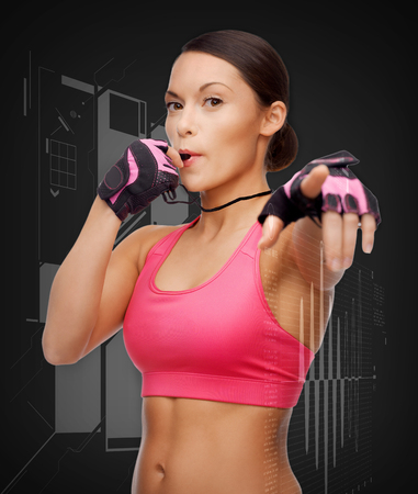 sport, fitness and healthcare concept - beautiful asian personal trainer with whistle photo