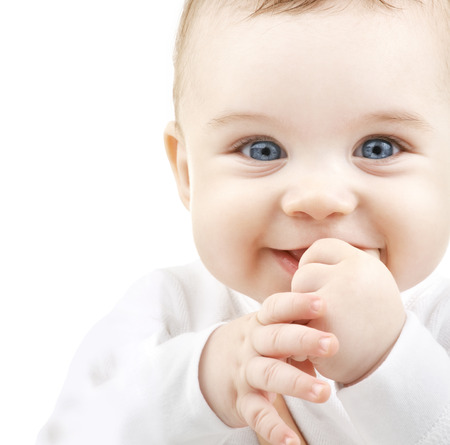 blue eyes: child, people and happiness concept - adorable baby