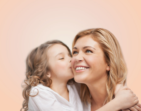 pretty preteen: family, child and happiness concept - hugging mother and daughter