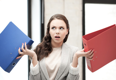 business concept - unsure thinking or wondering woman with folder photo