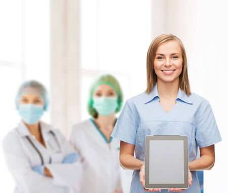healthcare, technology, advertisement and medicine concept - smiling female doctor or nurse and tablet pc computer with blank screen photo