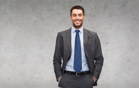 relaxed business man: business and office concept - handsome buisnessman