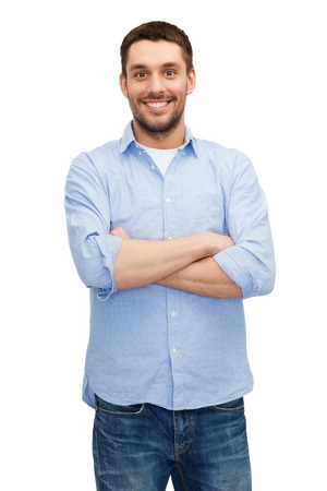 crossed arms: happiness and people concept - smiling man with crossed arms