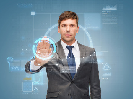 veto: business and office, ban, veto, warning concept - attractive buisnessman working with virtual screen