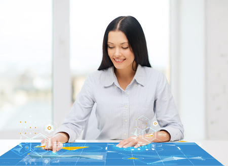 business, education and technology concept - smiling woman pointing to something or pressing imaginary button photo