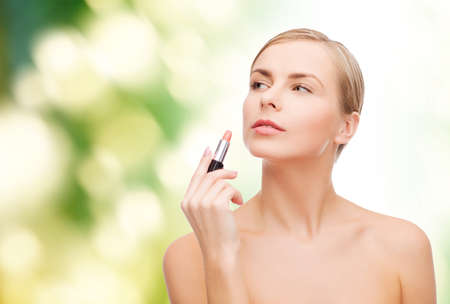 eco sensitive: cosmetics, health and beauty concept - beautiful woman with pink lipstick
