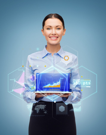 business, technology, internet and education concept - friendly young smiling businesswoman with tablet pc computer and virtual screen photo