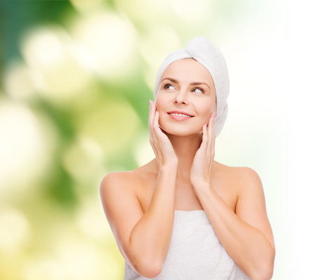 pampered: health, spa and beauty concept - beautiful woman in towel Stock Photo