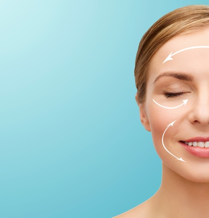plastic surgery: health and beauty concept - closeup of face of beautiful young woman with closed eyes