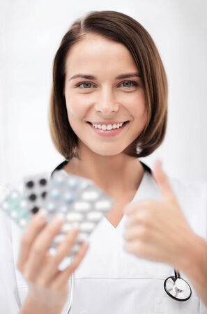 healthcare and medical concept - doctor with blister packs of pills Stock Photo - 27872290