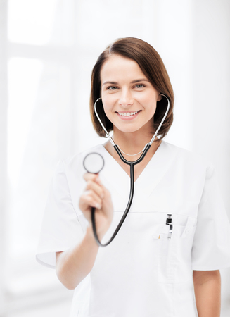 healthcare and medical concept - female doctor with stethoscope photo