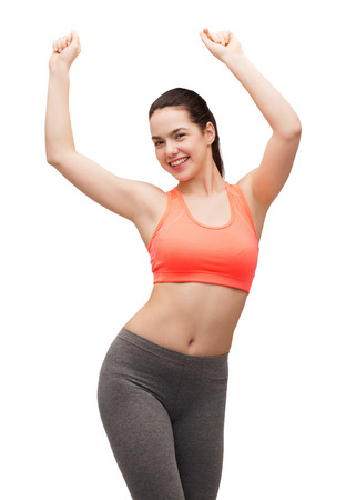la aptitud y el concepto de dieta - sonriente adolescente en el baile de ropa deportiva Foto de archivo