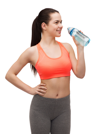 athletic wear: sport, excercise and healthcare - sporty woman with water bottle