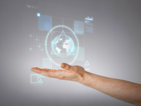 business and future technology concept - close up of male hand showing something photo