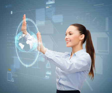 business and future technology concept - smiling businesswoman working with virtual screen photo