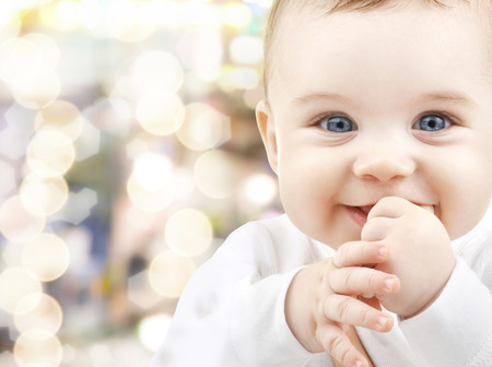 CHILD CARE: child, happiness and people concept - adorable baby Stock Photo