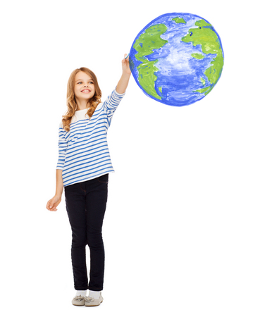 education, school, earth day and happy people concept - cute little girl drawing planet earth in the air Stock Photo