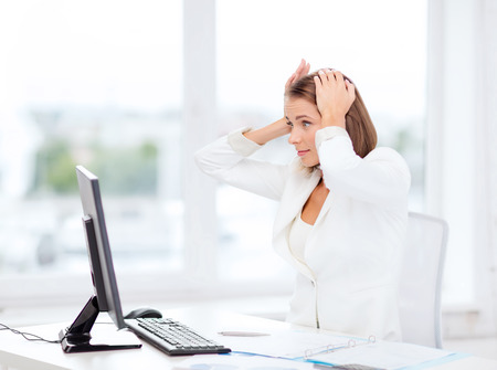 business, office, school and education concept - stressed businesswoman with computer at work photo