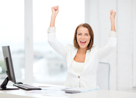 education concept: business, office, school and education concept - happy businesswoman with computer, papers and calculator in office Stock Photo