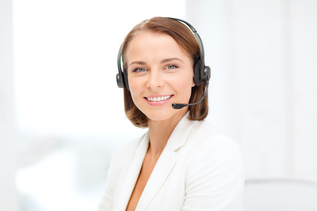 telephone operator: business, communication and call center concept - smiling female helpline operator with headphones in call center