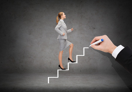 business and education concept - smiling businesswoman stepping up staircase photo