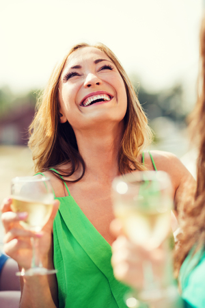 summer holidays, vacation and celebration - girl with champagne glass photo