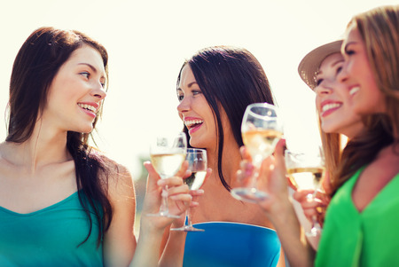 summer holidays, vacation and celebration - girls with champagne glasses photo