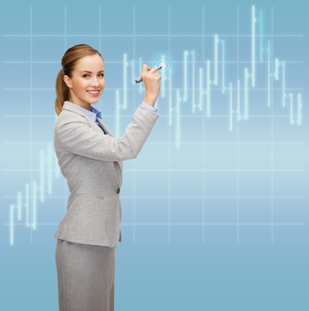 office, business and new technology concept - smiling businesswoman drawing forex chart in the air with marker photo
