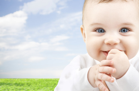 child, happiness and people concept - adorable baby photo